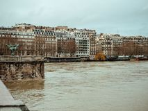 View from Pont de Bir-Hakeim in Paris with floodings of Seine Ri. View from Pont de Bir-Hakeim of French architecture and swollen river Seine embankments Royalty Free Stock Photos