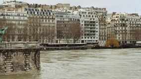 View from Pont de Bir-Hakeim in Paris with flooding of Seine River. View from Pont de Bir-Hakeim of French architecture and swollen river Seine embankments stock video