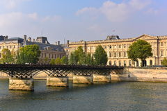 View of Pont des Arts bridge which is lined with lovers padlocks in Paris Stock Photo