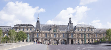 View from the Pont du Carousel bridge to the Louvre museum stock image