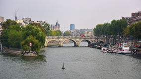 View of Pont Neuf arched stone bridge in Paris Stock Photos