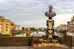 View of ponte s. Trinita from Ponte Vacchui. View of Ponte S. Trinita with the statue of Benvenuto Cellini in the foreground Stock Photo