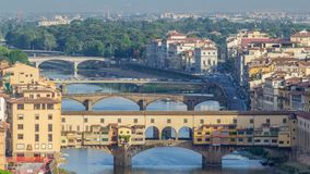 View on The Ponte Vecchio early morning timelapse, a medieval stone segmental arch bridge over the Arno River, in. View on The Ponte Vecchio early morning stock footage