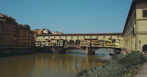 The view of Ponte Vecchio. The famous Arno river bridge from Uffizi Gallery. Also known as `Old Bridge`, it is one of the great icons of Florence, Italy and stock footage