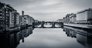 View from Ponte Vecchio, Florence, Italy (BW). A view downstream of the river Arno from the central Ponte Vecchio bridge - a classic tourist sight on a walk in Royalty Free Stock Image