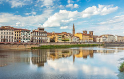 View of Ponte Vecchio with reflections in Arno River, Florence, Stock Image