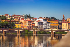 View of Ponte Vecchio with reflections in Arno River, Florence Stock Photo