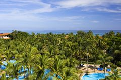 View on a pool, palms and Caribbean sea Stock Image