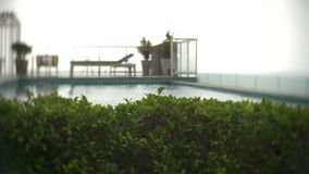 View of the pool on the roof overlooking the sea. 4k, background blur. stock video footage