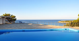 View from the pool to the sea. View from the pool on the Aegean Sea Royalty Free Stock Image