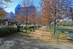 Winter time in Klyde Warren Park in Downtown Dallas. View of the popular Klyde Warren Park in Downtown Dallas with food trucks on the street Royalty Free Stock Photos