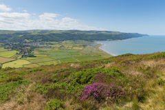 View of Porlock countryside Somerset England uk from the walk to Bossington beautiful countryside near Exmoor. On the south west coast path with purple heather stock photography