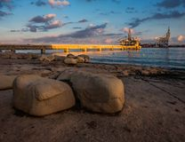 View of the port of Birzebbuja. Malta. Huge stones on the Birzebbuja embankment. View of the port. The beauty of the Maltese archipelago Stock Photos