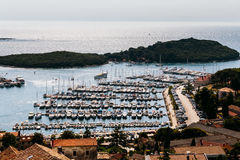 View of the port with boats and yachts from the bell tower of St. Anthony`s Church in the city Vrsar, Croatia stock photography