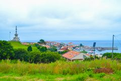 View of port of Comillas and Guell y Martos park, with Monument. Of Marquis of Comillas Monumento al Marques de Comillas at the background, in Comillas Stock Image