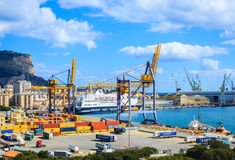 View of port with cranes, containers and city of Palermo in Sicily Stock Image