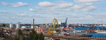 View of the port, cranes and containers and loading cargo ship Stock Photo