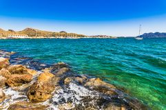 View of Port de Pollensa, seaside landscape at coast of Majorca, Spain. Beautiful view of the harbor at bay of Pollenca on Mallorca, Spain Mediterranean Sea Royalty Free Stock Photo