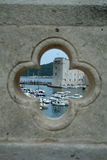 View on the port in Dubrovnik from the hole in bridge. The port is sharp and the wall is blurred Stock Photography