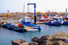 View on the Port of Gran Tarajal in Fuerteventura, Spain. Pictur. View on the boats and ships in the port in Gran Tarajal on the island Fuerteventura in Spain Stock Images
