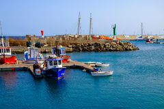 View on the Port of Gran Tarajal in Fuerteventura, Spain. Pictur. View on the boats and ships in the port in Gran Tarajal on the island Fuerteventura in Spain Stock Photography