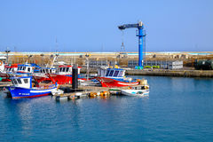 View on the Port of Gran Tarajal in Fuerteventura, Spain. Pictur. View on the boats and ships in the port in Gran Tarajal on the island Fuerteventura in Spain Royalty Free Stock Image