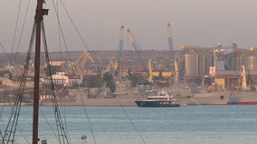 View of the port infrastructure and berths with ships. From the sea stock footage