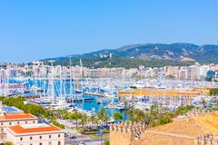 View of the port of Palma with luxury yachts from the terrace of the Cathedral of Santa Maria of Palma, also known as La Seu. Palma, Mallorca, Spain Stock Image
