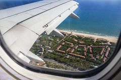 View from porthole of airplane wing stock photography