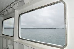 View from porthole of ferry crossing Poole harbour Stock Images