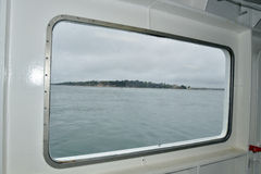 View from porthole of ferry crossing Poole harbour Royalty Free Stock Images