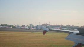 View through porthole landing aircraft on island Bali. Travel concept stock video