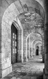 The view of portico roofed colonnaded terrace of the Malta Marit. Kalkara, MALTA - JULY 24, 2015: Black and white image of portico roofed colonnaded terrace of Royalty Free Stock Image