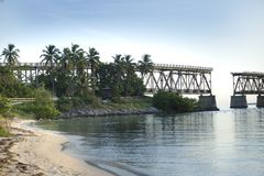 A portion of the Henry Flagler bridge where it opens in the Florida Keys with palm trees and a beach. stock images