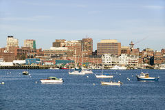 View of Portland Harbor boats with south Portland skyline, Portland, Maine Royalty Free Stock Photos