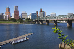 A view of Portland Oregon. Portland skyline Hawthorne bridge and canoes on the river Stock Photography