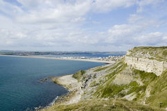 View from Portland to Weymouth. View from a stone quarry on the Isle of Portland looking across the Chesil Beach causeway to Weymouth on the Dorset Coast Royalty Free Stock Images