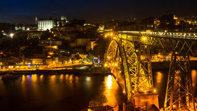 View of Porto and the Dom Luiz bridge at night time. Porto is called Northern capital of Portugal. Royalty Free Stock Photo