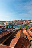View on Porto from Vila Nova de Gaia. View on Porto over roofs of lodges where the world famous Port wine is stored and aged. The lodges have become a major Stock Photography