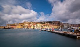 Portoferraio port in Elba. View of Portoferraio from harbor. Isle of Elba, Italy. Long exposure royalty free stock photo