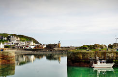 View of Portpatrick harbour with boat Stock Photos