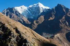 View of Portse village, mount cholatse and Tabuche peak Stock Photos