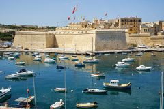 The view of Post of Castile from Kalkara over the Kalkara creek. The view of Post of Castile from Kalkara over the Kalkara creek with the yachts and boats Stock Images