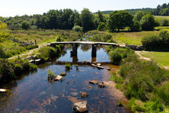 View from Postbridge clapper bridge Dartmoor National Park Devon England UK stock photos