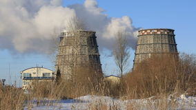 View of power heat station, smoke from the chimney on frosty winter day stock footage