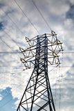 View of the power line against the clouds of blue sky in the sunlight. Electric, technology. stock photos