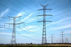 Rural High Voltage Electricity. View at power lines central Stock Photos
