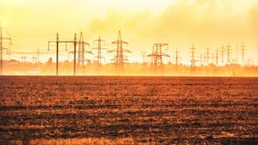 View of the power lines. At sunset stock photography