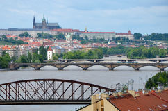 View of Prague Castle across the swollen river Vltava Stock Photo