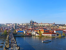 View of Prague Castle and Charles Bridge. Beautiful Scenario of Charles Bridge that leads to the Old Town of Prague from the Bridge Tower Royalty Free Stock Photo